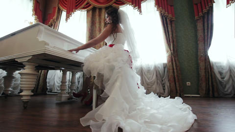 Bride Playing The Piano Indoors stock footage