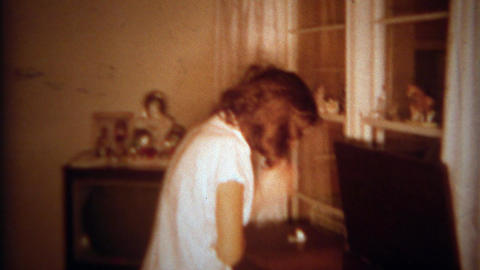 1966: Daughter pranked by mother awaking to loud music on vinyl record player. S Footage