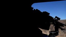 Chinook door gunner fires his machine gun Footage