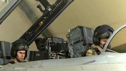 Royal Air Force pilots preparing Tornado jet in cockpit Footage