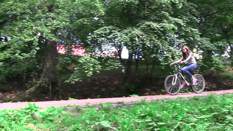 Group of cyclists descend on sloping driveway of the forest after entering inGro Footage