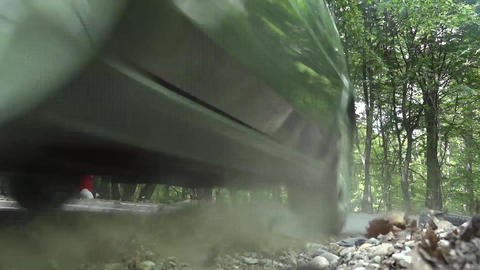 Rally car passed just video ca mera while accelerate through the green forest 13 Footage
