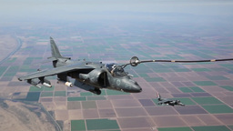 KC-130J Refuels Harrier AV-8B Jump Jet Fighters In Mid-air stock footage