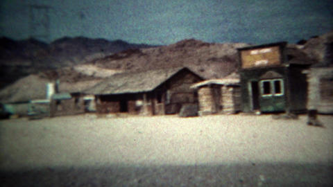 1973: Ghost town wagon trail log cabins and western railroad trains. RENO, NEVAD ライブ動画