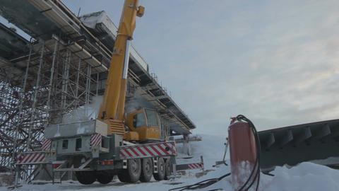 Building Crane Works on Bridge Section Footage