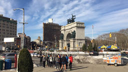 Pedestrians crossing the street by Grand Army Plaza
