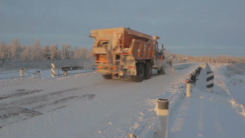 Large Truck Moves on Snowy Highway Footage
