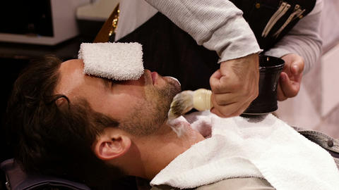 Man getting his beard shaved with shaving brush Footage