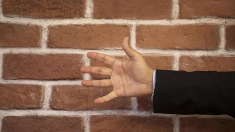 Hand counting from down to five - Brick wall background Footage