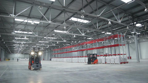 Cargo Machine Moves in Spacious Warehouse Footage