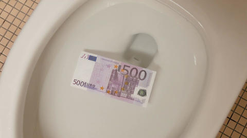 Video of flushing euro banknotes in toilet bowl in 4K Footage