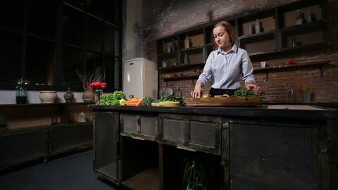 Charming woman preparing smoothie in kitchen Footage