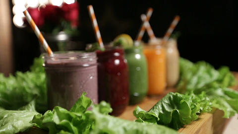 Jars of various smoothies with straws for dieting Footage