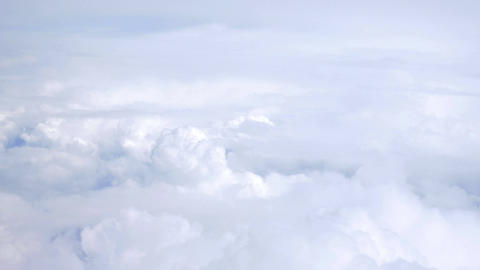 Aerial shot above the clouds in 4K Footage