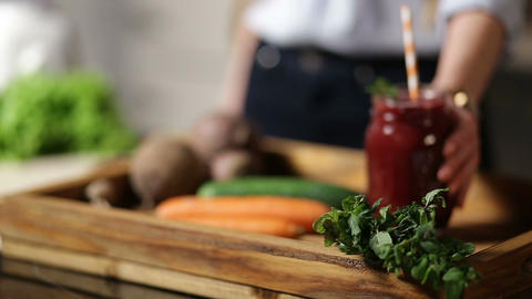 Healthy beet smoothie in mason jar on wooden tray Footage