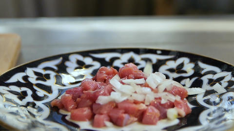 Macro Cut Meat Cubes on Plate Cut Onion is Poured Footage