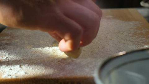 Closeup Hands Put Dough Shaped in Rolling-pin on Board Footage