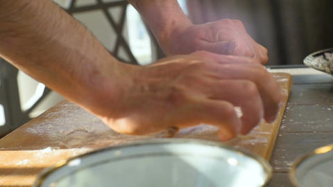 Closeup Cook Rolls Dough Circles on Board Footage