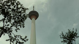 Malaysia Kuala Lumpur 035 KL television tower against cloudy sky Footage
