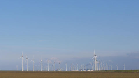 Windmill turbine park near heavy industry Footage