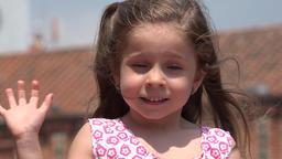 Pretty Female Child Waving Footage
