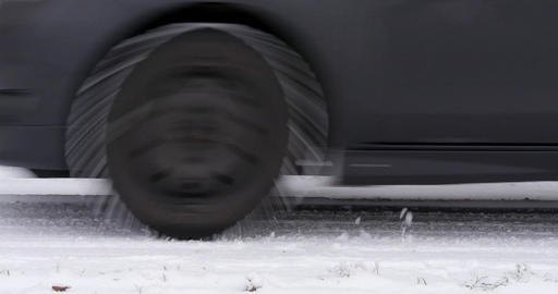 Car passing by on snowy road Footage