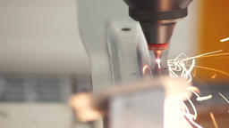 metal laser cutting detail using the robotic arm Footage