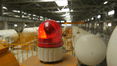 Closeup Flashing Red Lamp on Machine in Workshop Footage