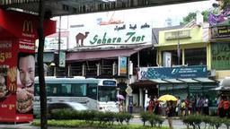 Malaysia Kuala Lumpur 048 it's raining in a downtown street Footage