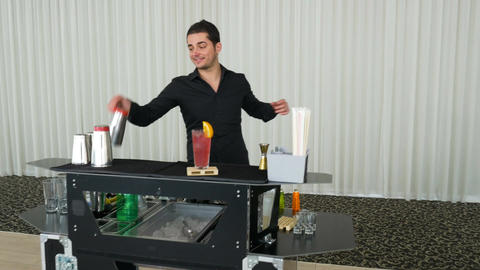 Bartender juggling bottles and shaking cocktail at a mobile bar Footage
