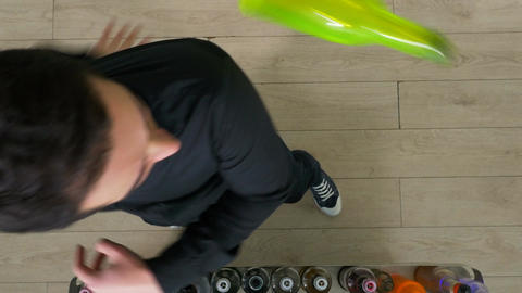 Top view of enthusiastic bartender making flair bartending moves with a bottle Footage
