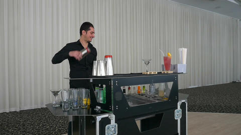 Entertainer making flair bartending moves with shaker at a bar in slow motion Footage