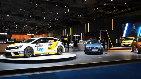Opel Motor show stand with an Opel Astra race car Stock Video Footage