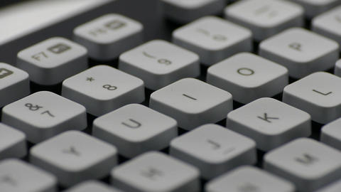 1080p Ungraded: Rotating English PC Keyboard Around Keys With Letters, Digits Live Action