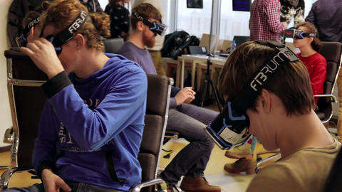 1080p Group of People Watch 3D Movie With Virtual Reality Headsets / VR Phone Footage