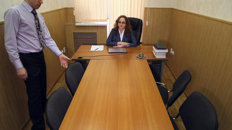Meeting in the office of the director Footage