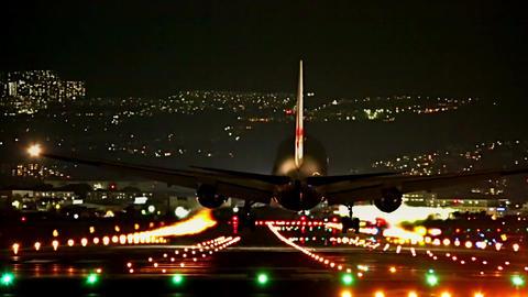 big plane landing at dusk Footage