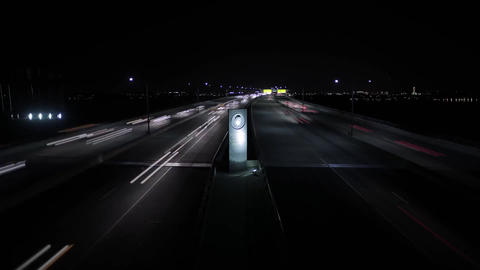 View of the Road in the Night-Time. the Road Going Car With Headlights Included. Footage