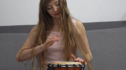 Girl Playing On Ethnic Drums Slow Motion Footage