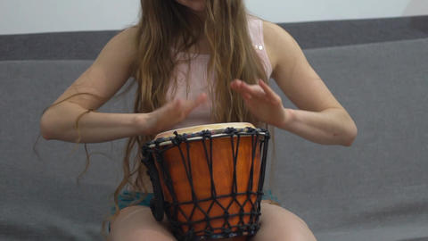 Djembe Played By A Woman Slow Motion Footage
