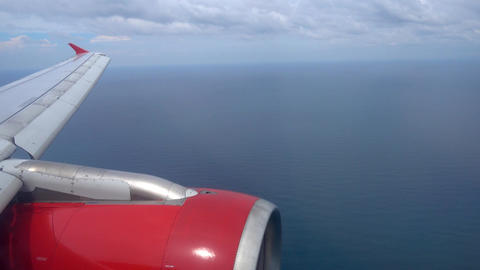 looking on wing with engine and sea Footage