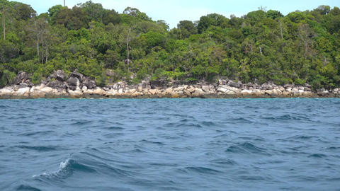View from boat on stone coast of Koh Lipe island Footage