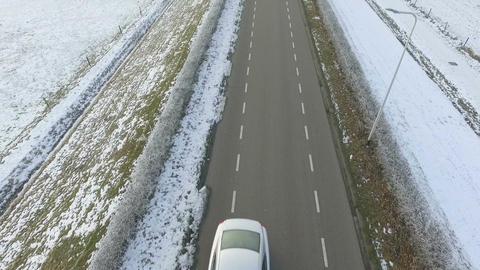 Aerial shots of Dutch winter landscape, tilt up to road Footage