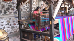 Woman weaving cotton in an old traditioan machine Footage