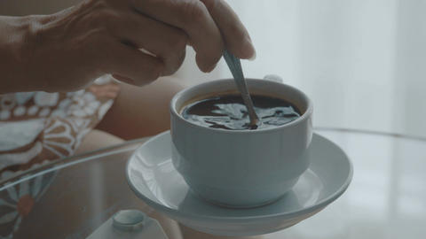 Woman stirring coffee Footage