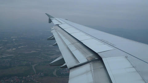 Wing of airplane flying in the sky Footage