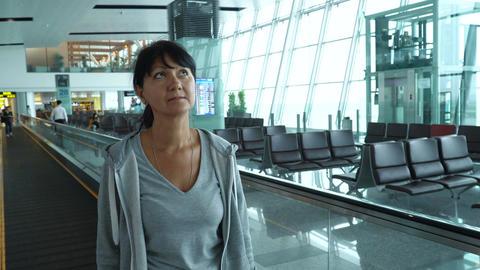 Woman walks travelator at empty airport hallway Footage