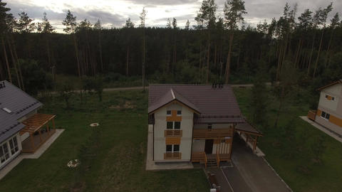 Upper View Two Storied Cottages among Forest Footage