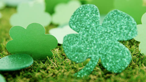 Close up view of sparkly green shamrock on grass for st patricks day Live Action