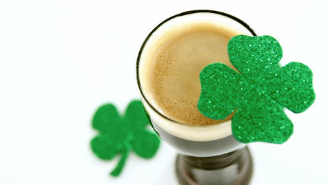 Pint of guinness with shamrocks for st patricks day Live Action